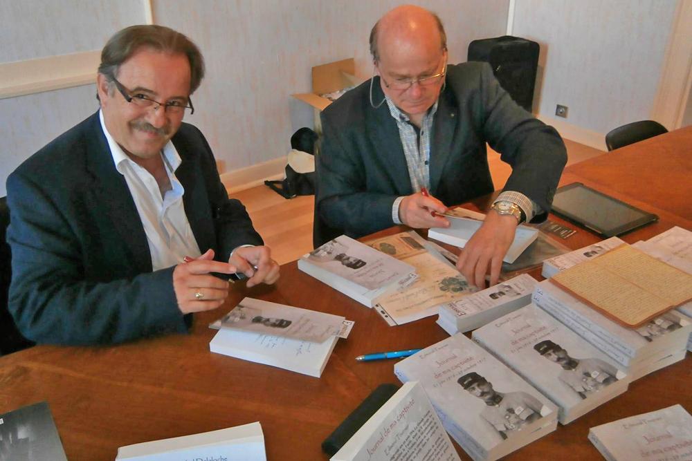 Philippe et Yves Tournier, les petits-fils d'Edmond Tournier, lors de la sortie officielle du livre à la CCI de Dieppe.